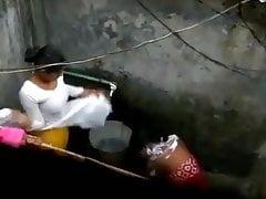 Indian housewife bathing
